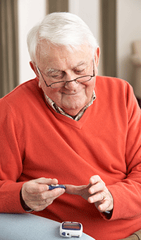 elderly man with diabetes blood test - forbes opticians, hadleigh, essex